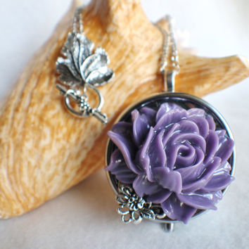 Music box locket, round locket with music box inside, in silver with purple rose and silver filigree accent, permanently sealed