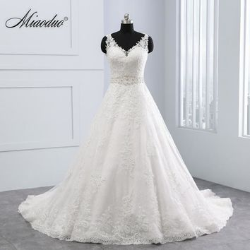 New Design Ball Gown Lace Appliques Wedding Dresses V-Neck Crystal Backless Sexy Wedding Gowns