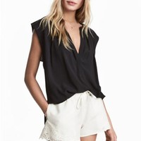 Sleeveless blouse - Black - Ladies | H&M CA