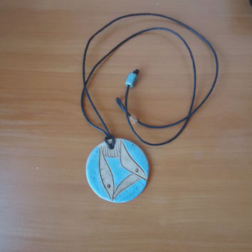 FREE SHIPPING! Handmade ceramic pendant. Clay medallion. Blue and beige. Fish decoration.