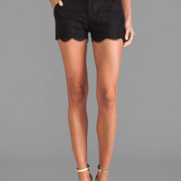 Alice + Olivia Wide Waistband Scallop Shorts in Black