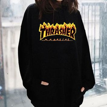 ThrasherMen and women with the flame hooded couples sweater Black-yellow letters Black