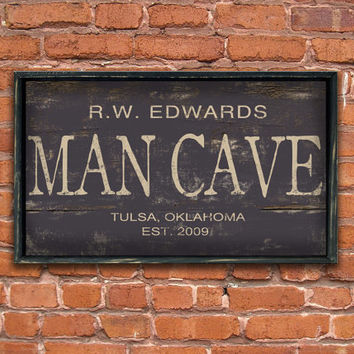 "Personalized wooden ""Man Cave"" sign framed out in distressed black frame.  Handmade.  Approx.  19""x12""x2"""