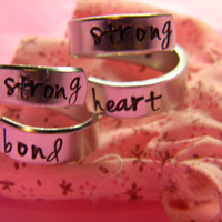 strong bond strong heart set of two aluminum spiral ring for sisters , best friends, cousins