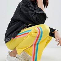 ASOS DESIGN Trackpants with Rainbow Side Stripe and Vent Detail at asos.com