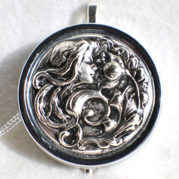 Music box locket, round locket with music box inside, in silver with Victorian Maiden in garden