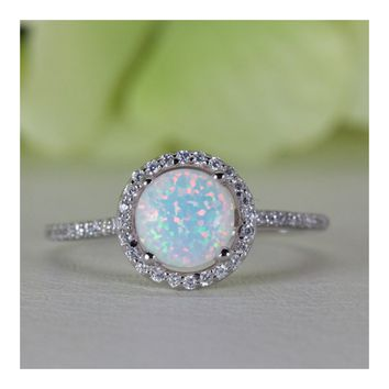 Halo Round Cabochon Lab-Created Opal With Fine Quality Cubic Zirconia Ring in Sterling Silver