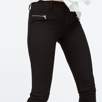 Seamed and zipped trousers