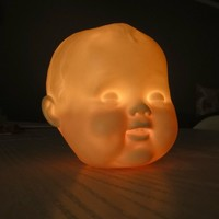 Porcelain Baby-doll head tea-light or votive cover