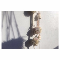 Textile wall hanging with pom poms, quartz crystals, glass and horn Ghanian beads on long cream cotton rope boho home decor