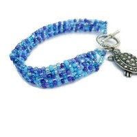 Blue Beaded Bracelet with Turtle Charm
