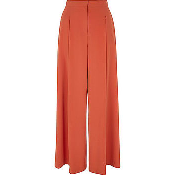 Rust orange wide leg trousers