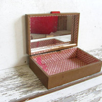 vintage jewelry box with tooled floral top.. lined red and white with mirror