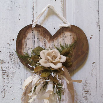 Shabby chic heart wall hanging white and cream distressed embellished bisque heart tattered ribbon Anita Spero