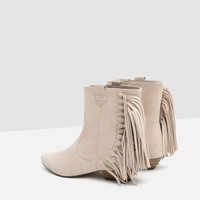 FLAT LEATHER ANKLE BOOTS WITH FRINGE