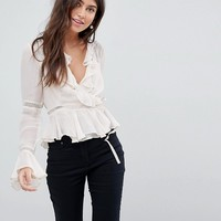 ASOS DESIGN Wrap Top With Ruffle and Lace Insert at asos.com