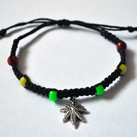 Jamaican Rasta Inspired Hemp Adjustable Bracelet with Marijuana Leaf Charm Red, Green, Yellow beads and Black Hemp Rastafarian Colors