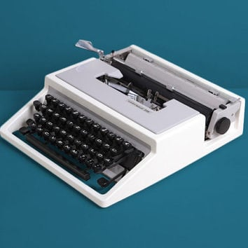 1975 Underwood 310 Typewriter. Excellent working conditon. Design by Ettore Sottsass. Olivetti Dora. White and gray. With Case.