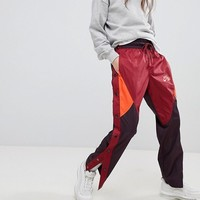 Nike Colourblock Woven Popper Track Pants at asos.com