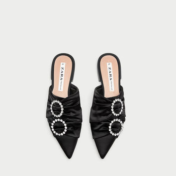 FLAT POINTED MULES WITH BEADED DETAIL DETAILS