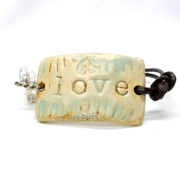 Aromatherapy bracelet, ceramic bracelet, stoneware, leather bracelet, stamped bracelet, love stamp, handcrafted in Tennessee
