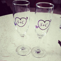 Personalized initials in a heart & arrow toasting flutes