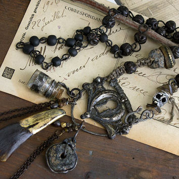 A Message Along the Way: Message in bottle keyhole buffalo tooth skull dark tribal infused necklace