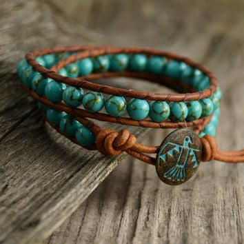 Turquoise beaded leather wrap bracelet. Thunderbird boho chic stack bracelet