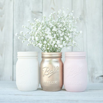 Pink and rose gold wedding centerpieces, mason jar vases.