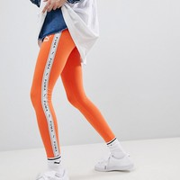 Puma Exclusive To ASOS Taped Side Stripe Leggings In Orange at asos.com