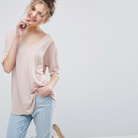 ASOS Oversized T-Shirt with V Neck and Dip Back in Rib at asos.com