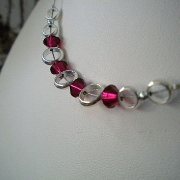 Floating Silver Circles Necklace with Red Swarovski Beads