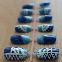 Dark to Light Blue Gradient with White Tribal Designs on a Press On Nail Set