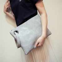 *online exclusive* envelope clutch bag with wristlet