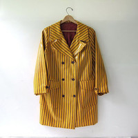 vintage 1960s yellow raincoat. striped rain jacket. double breasted vinyl spring coat.