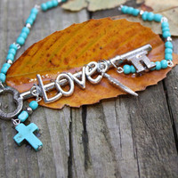 Rear view mirror key charm. A Vintage key, the word LOVE , a turquoise colored cross and turquoise beads to hang in your car.