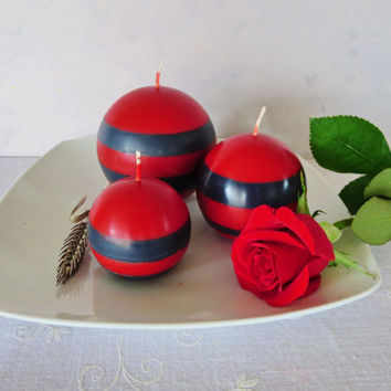 Red and black soy ball candles, scented red and black earth friendly candles, red and black candles, soy sphere candles in red and black.