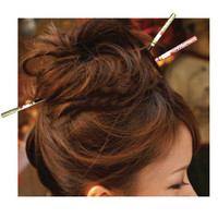Is it racist for a non-asian to wear chopsticks in hair?