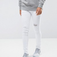 ASOS Extreme Super Skinny Jeans In White With Distressing at asos.com