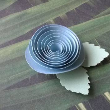 light blue rose boutonniere groomsman pin back groom paper flower lapel brooch bridal party bridal shower wedding reception family favors