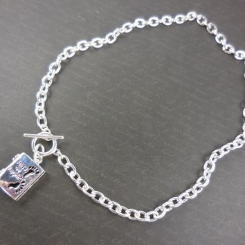 """Follow the Footprints"" Locket Toggle Necklace - Silver Plated"