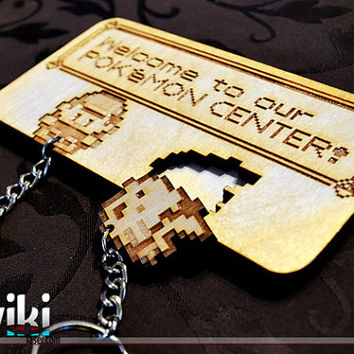 """Laser cut and engraved """"Pokémon Center"""" wall key holder with keyrings included"""