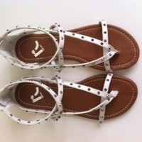 Strap white spiked sandals.