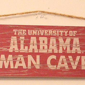 "NCAA Distressed Man Cave Plaque NCAA Team: University of Alabama. Crimson Tide Wooden Sign Decorated with Team Logo and Colors Dimensions: 24"" X 6"" Officially Licensed. Wall Sign. Home Decor."