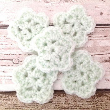 Pale green crocheted flowers