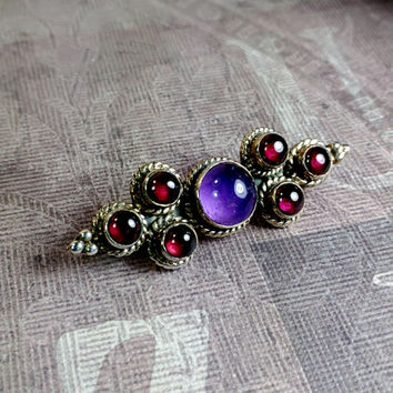 Small silver 925 ruby red and bright purple glass possibly stone ornate brooch pin.