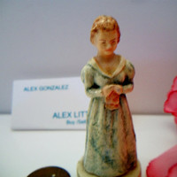 lady in blue dress holding a hankie vintage miniature figurine 1940s
