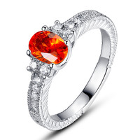 Sterling Silver Orange-Red Oval and Clear Round Cubic Zirconia Engagement Ring