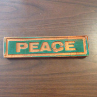 Peace Word Sign Carved In Wood Rectangle Green and Wood Stained Oak