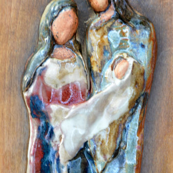 Handcrafted Ceramic Pottery Family Set  . Sculpture in  Pottery ceramic of a Family.  Ceramic tile on a stained wood by Elena Madureri